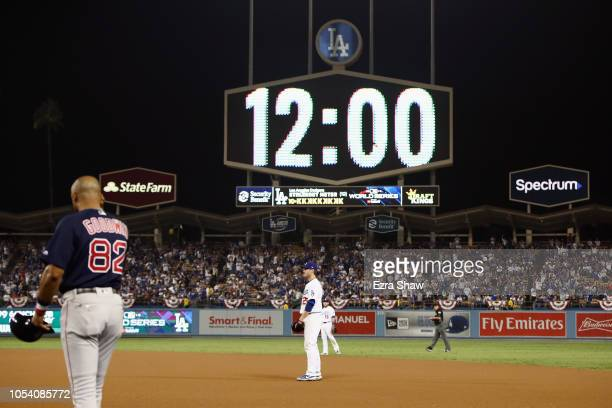 The scoreboard shows 1200am as Game Three of the 2018 World Series between the Los Angeles Dodgers and the Boston Red Sox enters the seventeenth...
