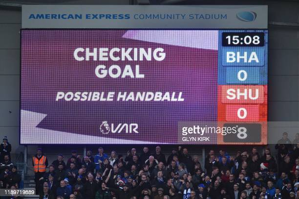 The scoreboard shows a VAR review for handball after Sheffield United's Irish defender John Egan scores subsequently disallowed during the English...