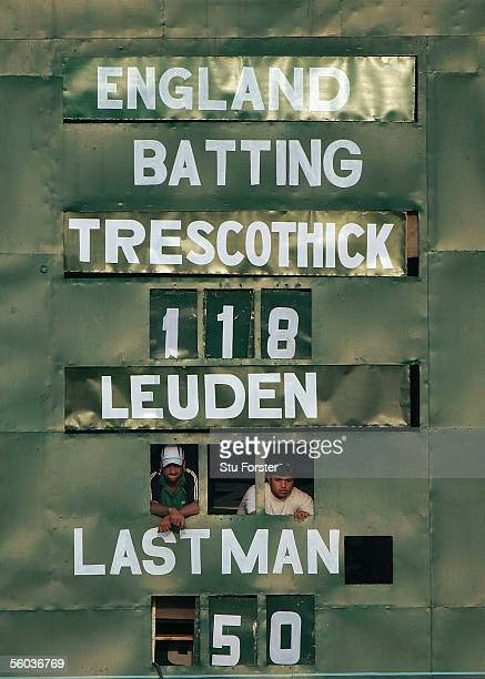 The scoreboard shows England batsman Marcus Trescothick after reaching his century and Alex Loudon during the first day of the three day game between...
