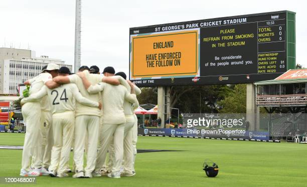 The scoreboard shows England enforce the follow on as the team have a huddle during Day Four of the Third Test between England and South Africa on...