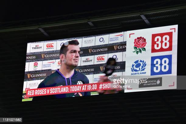 The scoreboard shows Scotland's captain Stuart McInally being interviewed after the Six Nations international rugby union match between England and...