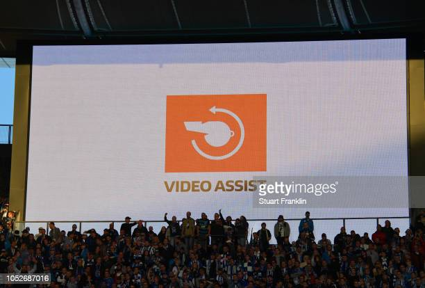 The scoreboard shows that a VAR decision is being made during the Bundesliga match between Hertha BSC and SportClub Freiburg at Olympiastadion on...