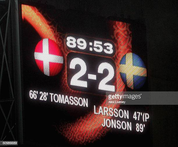 The scoreboard shows that both teams qualify for the quarter finals during the UEFA Euro 2004, Group C match between Denmark and Sweden at the Bessa...