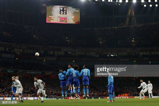 The scoreboard shows the 02 scoreline as Ostersunds' Iranian striker Saman Ghoddos takes a freekick during the second leg of the Europa League Round...