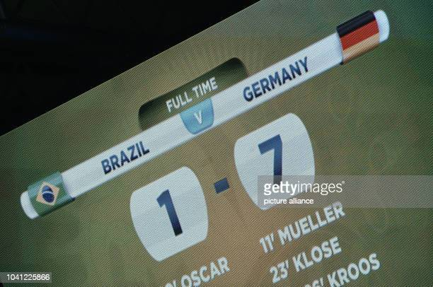 The scoreboard shows the 1-7 final score after the FIFA World Cup 2014 semi-final soccer match between Brazil and Germany at Estadio Mineirao in Belo...