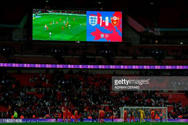 The scoreboard shows the 70 scoreline as players leave the pitch after the UEFA Euro 2020 qualifying first round Group A football match between...