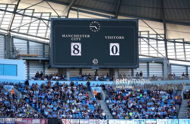 The scoreboard shows the 80 scoreline after the Premier League match between Manchester City and Watford FC at Etihad Stadium on September 21 2019 in...