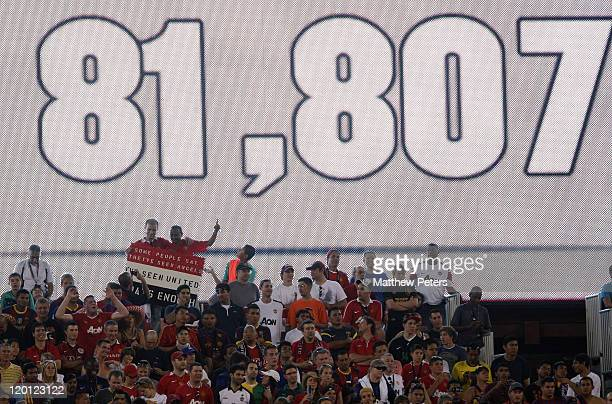 The scoreboard shows the attendance of 81,807 during the pre-season friendly match between Manchester United and Barcelona as part of their...