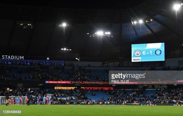 The scoreboard shows the final 6-1 score after the English League Cup third round football match between Manchester City and Wycombe Wanderers at the...