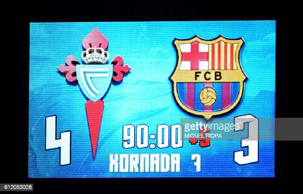 The scoreboard shows the final result at the end of the Spanish League football match RC Celta de Vigo vs FC Barcelona at the Balaidos stadium in...