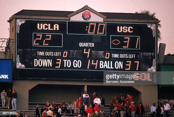 The scoreboard shows the final score between the USC Trojans and the UCLA Bruins at the Rose Bowl on November 19 1988 in Pasadena California The...
