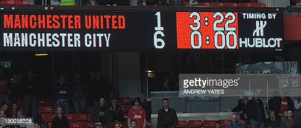 The scoreboard shows the final score in the English Premier League football match between Manchester United and Manchester City at Old Trafford in...