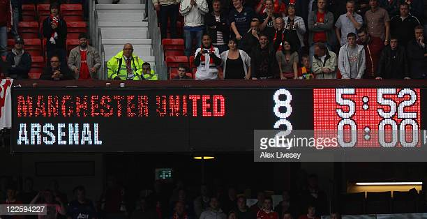 The scoreboard shows the final score of the Barclays Premier League match between Manchester United and Arsenal at Old Trafford on August 28 2011 in...