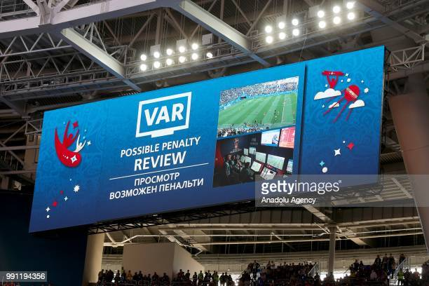 The scoreboard shows the review of a position with the Video Assistant Referee system during the 2018 FIFA World Cup Russia Round of 16 match between...