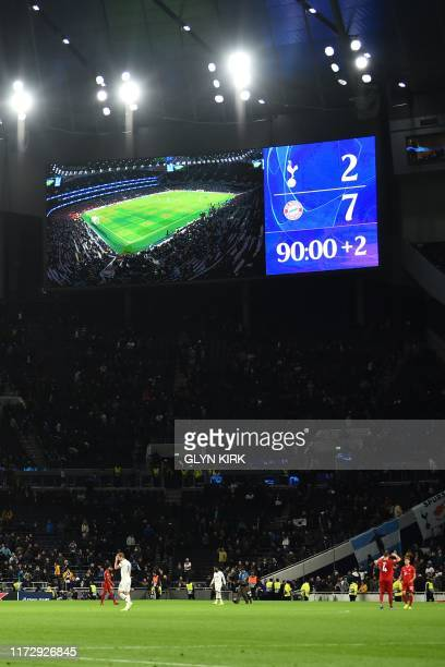 The scoreboard shows the score as the whistle goes in the UEFA Champions League Group B football match between Tottenham Hotspur and Bayern Munich at...