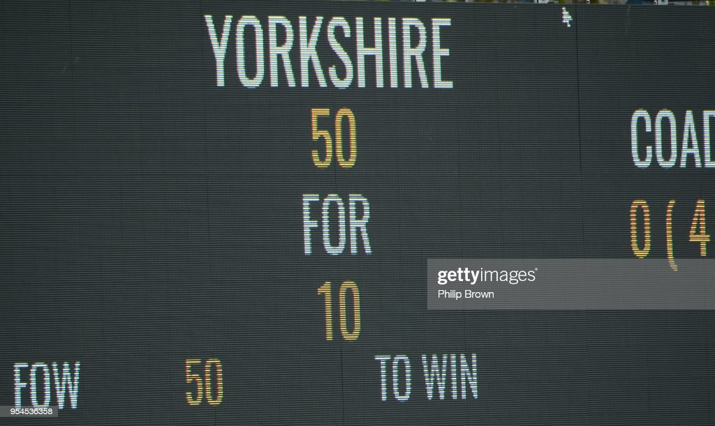 The scoreboard shows Yorkshire bowled out for 50 runs in their first innings during day one of the Specsavers County Championship Division One cricket match between Essex and Yorkshire at the Cloudfm county ground on May 4, 2018 in Chelmsford, England.
