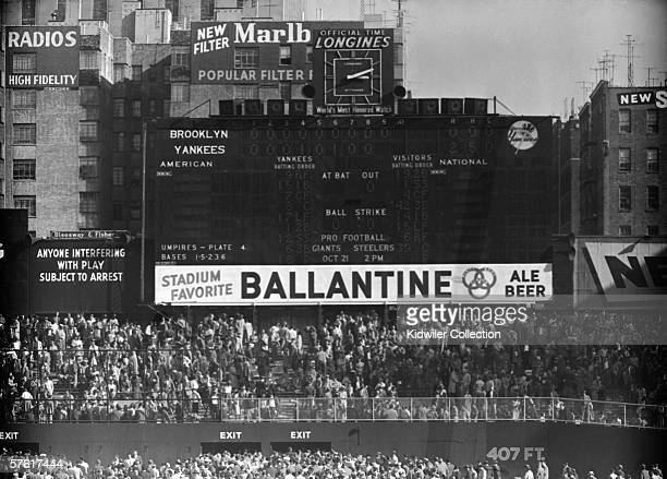 The scoreboard tells the story as fans leave Yankee Stadium after the fifth game of the World Series on October 8 1956 between the Brooklyn Dodgers...