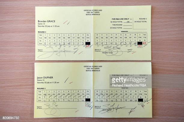 The scorecards of Branden Grace of South Africa who shot a 62 the lowest round in major championship history and Jason Dufner of the United States...