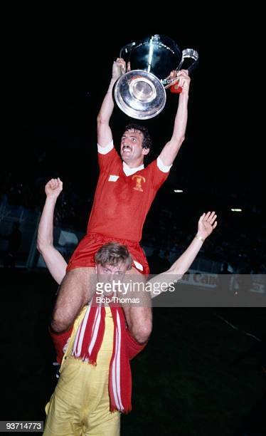 The scorer of Liverpool's winning goal Alan Kennedy and the trophy are carried by a Liverpool fan after the Liverpool v Real Madrid European Cup...