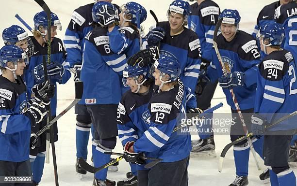 The scorer of the winning goal Antti Kalapudas and Kasper Bjoerkqvist celebrate after defeating Sweden 21 at the 2016 IIHF World Junior Ice Hockey...