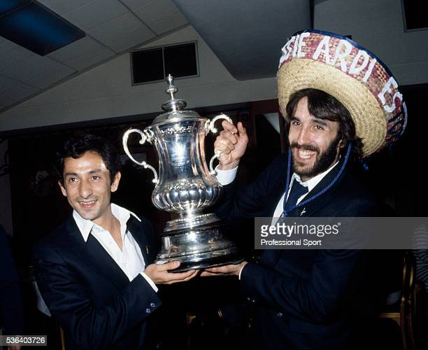 The scorer of the winning goal for Tottenham Hotspur Ricardo Villa celebrates with his Argentinian teammate Osvaldo Ardiles and the FA Cup at the...