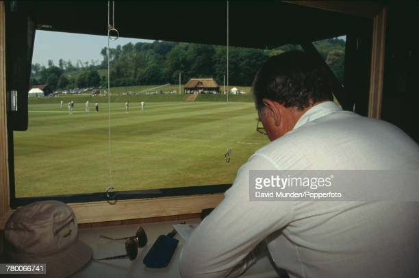 The scorer watches play during a charity match between the MCC and Sir Paul Getty's XI at Getty's new cricket ground on his Wormsley Park estate in...