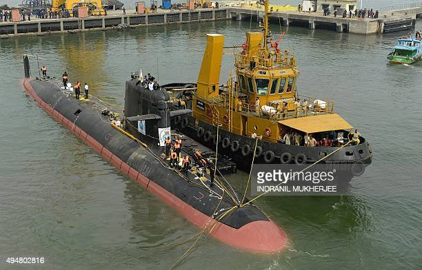 The Scorpene submarine 'Kalvari' is escorted by tugboats as it cruises into the Naval Dockyard in Mumbai on October 29 2015 'Kalvari' the first...