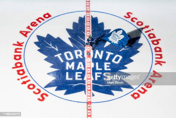 The Scotiabank skater waves a Toronto Maple Leafs flag before the start of the first period at the Scotiabank Arena on February 1, 2020 in Toronto,...