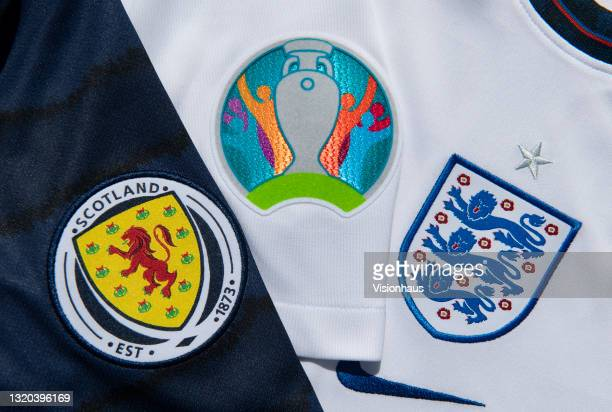 The Scotland and England badges on their home shirts with the logo for the Euros on May 27, 2021 in Manchester, United Kingdom.