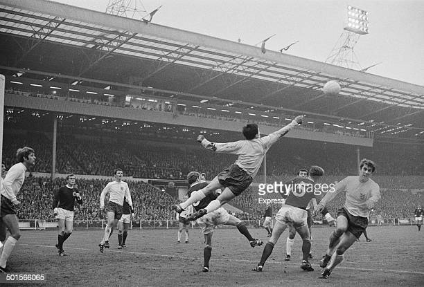 The Scotland goalkeeper makes a clearance during a British Home Championship match against England at Wembley Stadium London 10th May 1969 On the far...