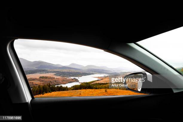 the scotland highlands view in autumn from the car. - road stock pictures, royalty-free photos & images