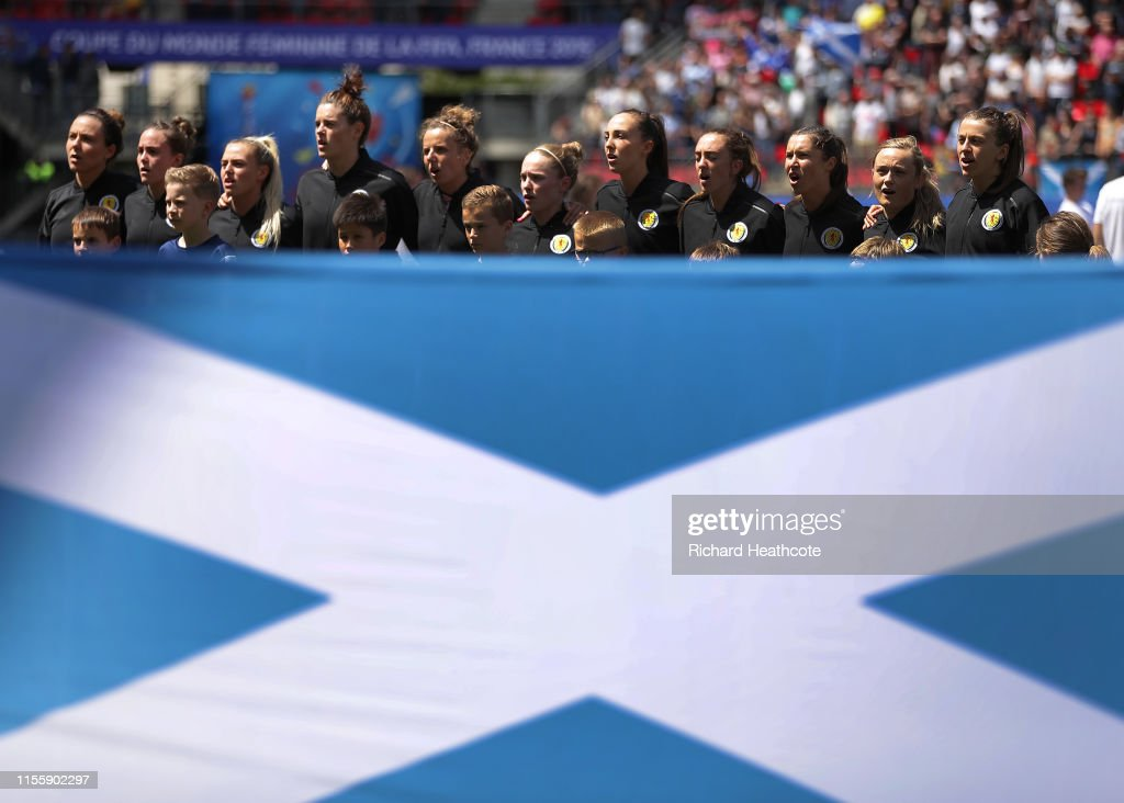The Scotland players are seen singing the national anthem