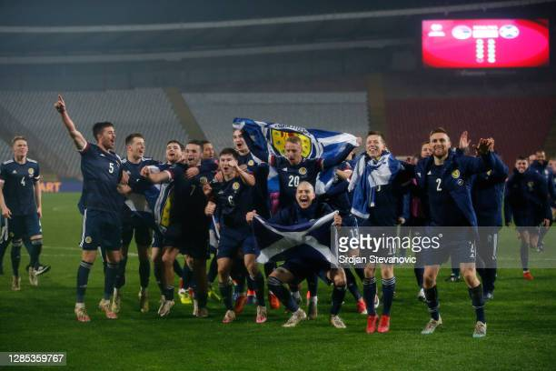 The Scotland side celebrate at the final whistle during the UEFA EURO 2020 Play-Off Final between Serbia and Scotland at Rajko Mitic Stadium on...