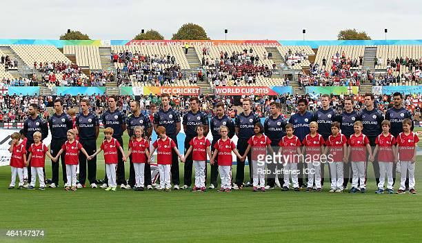 The Scotland team acknowledge their National Anthems during the 2015 ICC Cricket World Cup match between England and Scotland at Hagley Oval on...