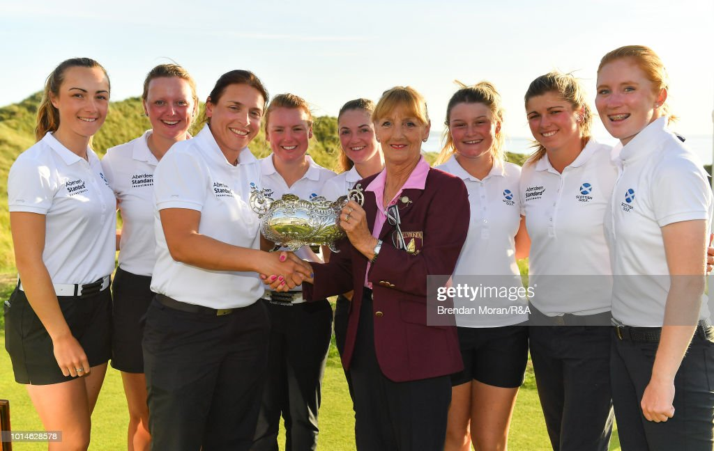 The Scotland team are presented with the Hugh Kelly Cup by Nora Quaid, Lady Captain, Ballybunion Golf Cub, after winning the Ladies' title at the Ladies' and Girls' Home Internationals at Ballybunion Golf Club on August 10, 2018 in Ballybunion, Ireland.