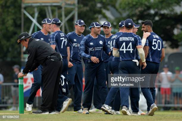 The Scotland team celebrate as Adil Rashid of England is run out during the One Day International match between Scotland and England at The Grange on...