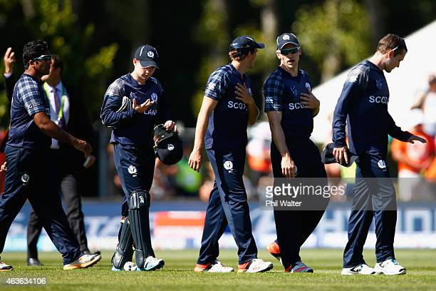 The Scotland team leave the field after their defeat in the ICC Cricket World Cup match between New Zealand and Scotland at University Oval on...