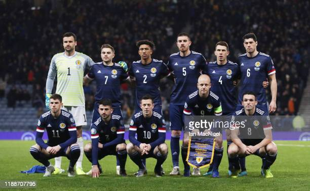 The Scotland team line up prior to the UEFA Euro 2020 qualifier between Scotland and Kazakhstan at Hampden Park on November 19, 2019 in Glasgow,...