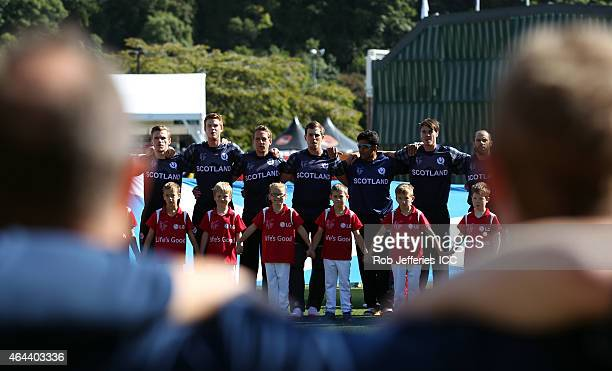 The Scotland team observe their National Anthem during the 2015 ICC Cricket World Cup match between Afghanistan and Scotland at University Oval on...