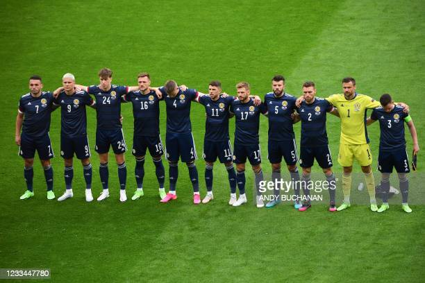 The Scotland team stand to sing their national anthem ahead of the UEFA EURO 2020 Group D football match between Scotland and Czech Republic at...