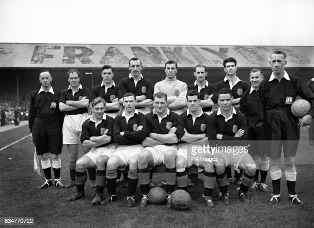 The Scotland team who defeated Wales Back row lr James Scoular Allan Brown Frank Brennan George N Farm Samuel R Cox George G M Aitken and referee...