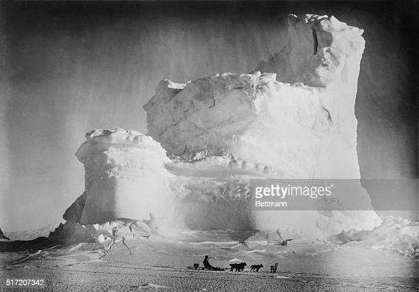 The Scott Expedition Lonely dogsled driven in front of bizarre ice castle
