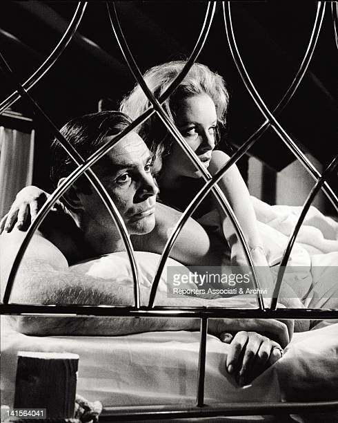 The Scottish actor Sean Connery plays the role of secret agent James Bond on the bed with the Italian actress Luciana Paluzzi, who is Fiona Volpe, a...