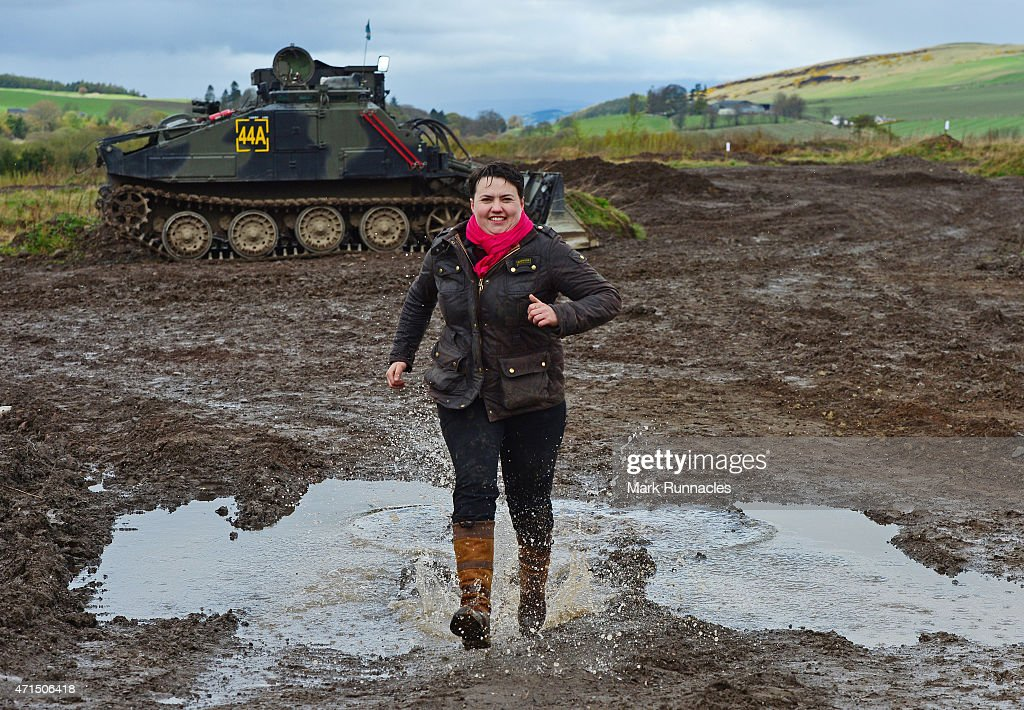 The Scottish Conservative Leader Ruth Davidson splashes through a pubddle after getting behind the wheel of a Tank at Auchterhouse Country Sports, as she highlights how the country's military and defences are best served by the party on April 29, 2015 in Dundee, Scotland. Britain goes to the polls in a General Election on May 7.