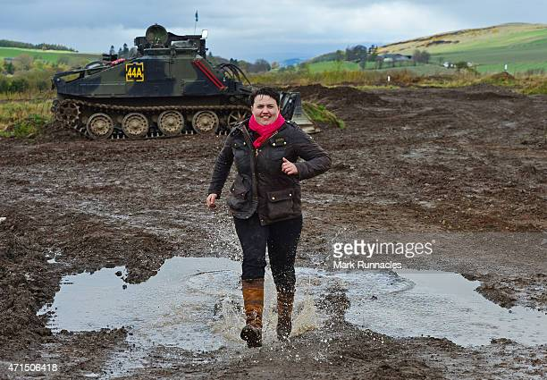 The Scottish Conservative Leader Ruth Davidson splashes through a pubddle after getting behind the wheel of a Tank at Auchterhouse Country Sports as...