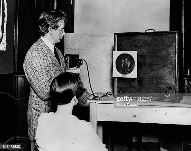 The Scottish engineer John Logie Baird demonstrates the receiving station of his most famous invention the television in 1926