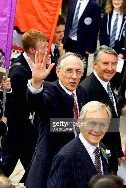 The Scottish First Minister Donald Dewar waves as he and Presiding Officer Sir David Steel arrive for the opening the new Scottish Parliament in...