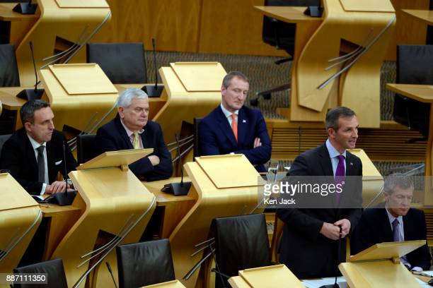 The Scottish Liberal Democrat group in the Scottish Parliament listen as Liam McArthur opens a Lib Dem debate on policing on December 6 2017 in...