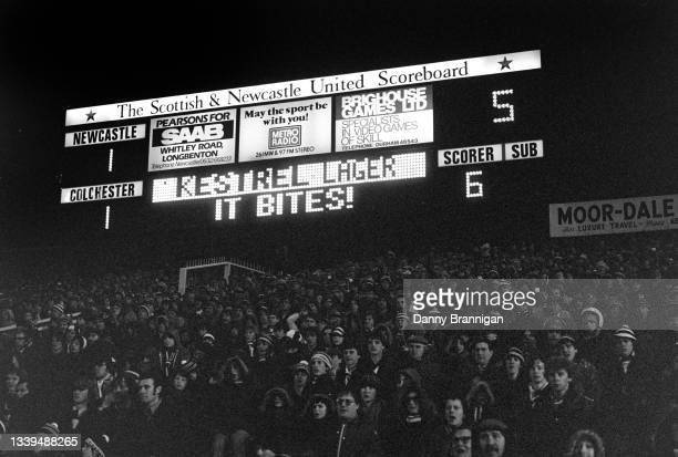 The Scottish & Newcastle United electronic scoreboard at the back of the Gallowgate End shows the 1-1 scoreline and the advertising slogan for...
