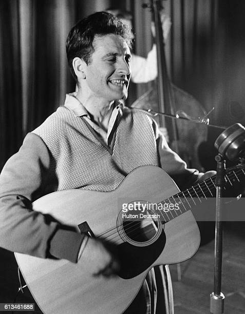 The Scottish rock n' roll star Lonnie Donegan performing on stage in 1956 the year in which he had a hit with Rock Island Line